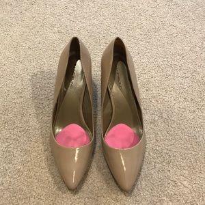 Nude closed toed heels
